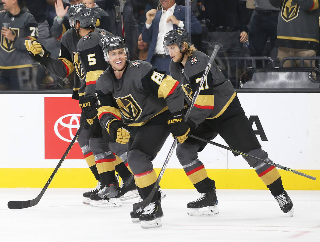 Vegas Golden Knights center Jonathan Marchessault (81) celebrates with teammates after assistin ...