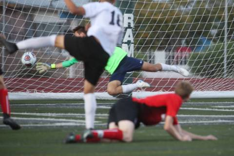 Las Vegas' Sergio Aguayo (18) scores against Coronado's Josue Ruiz during the Southern Nevada b ...