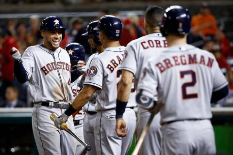 Houston Astros' George Springer celebrates after a two-run home run against the Washington Nati ...