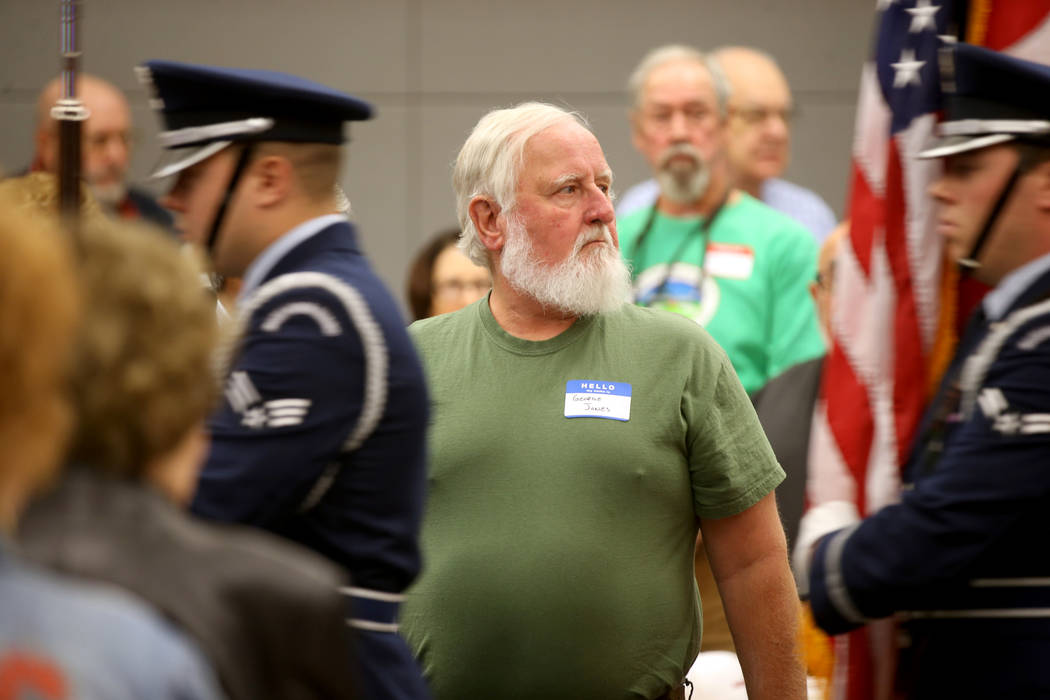 """George """"Rabbit"""" Jones, 70, of Las Vegas stands for the Nellis Air Force Base Color Guard during ..."""