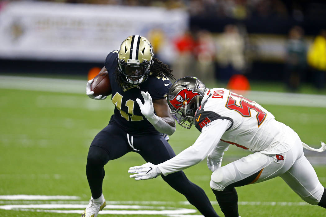 New Orleans Saints running back Alvin Kamara (41) carries against Tampa Bay Buccaneers outside ...
