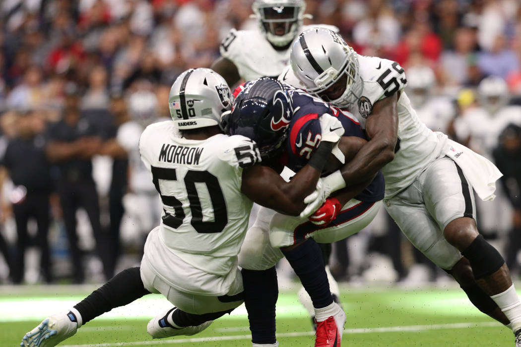 Houston Texans running back Duke Johnson (25) is tackled by Oakland Raiders linebacker Nicholas ...