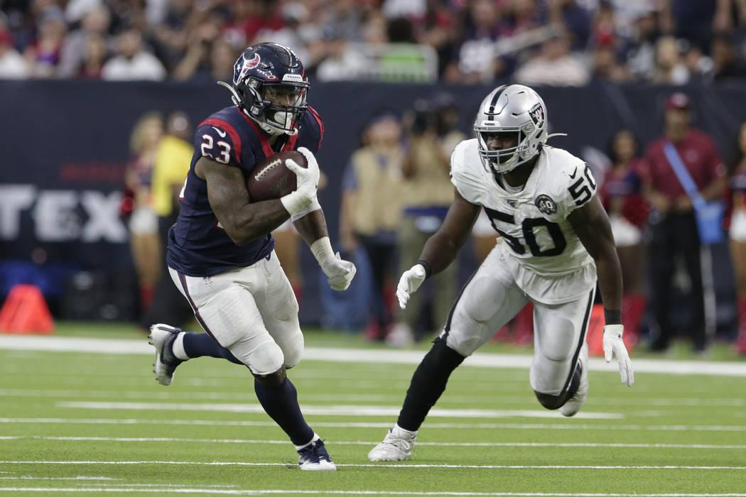 Houston Texans running back Carlos Hyde (23) and Oakland Raiders linebacker Nicholas Morrow (50 ...