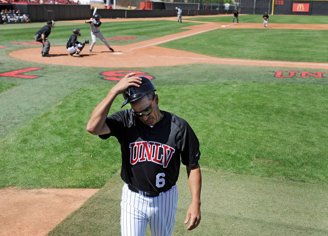 UNLV Baseball Head Coach Tim Chambers returns to the dugout during his baseball game against Sa ...