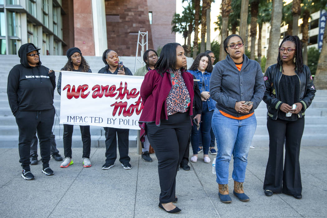 Kelly Williams, center, speaks during a rally to honor Atatiana Jefferson outside the Regional ...