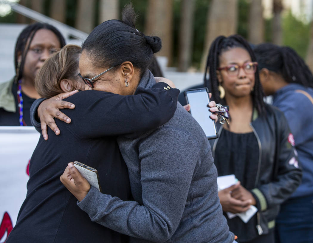 Kelly Williams, right, is hugged by Alma Chavez after speaking during a rally to honor Atatian ...