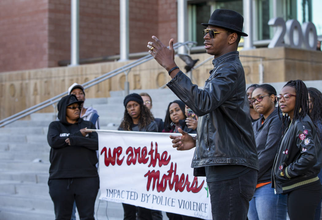 Rev. Stretch Sanders offers some words of strength during a rally to honor Atatiana Jefferson o ...