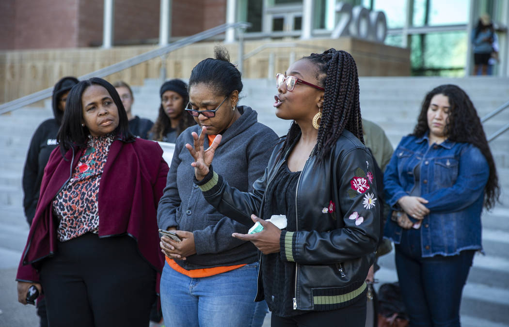 Marcie Wells, right, speaks during a rally to honor Atatiana Jefferson outside the Regional Jus ...