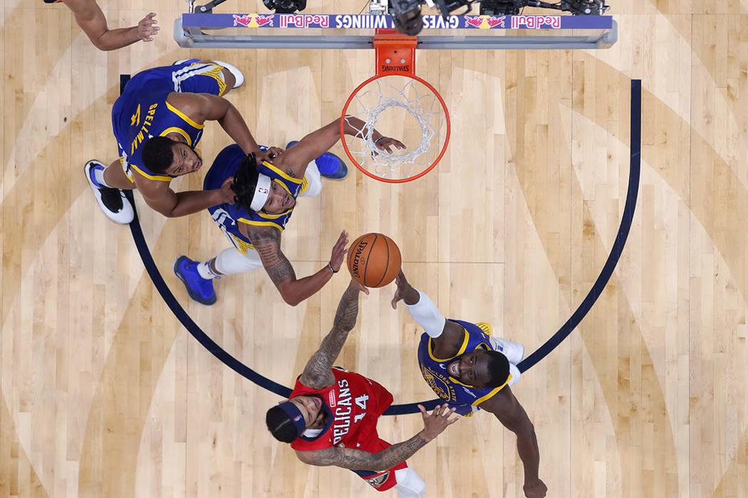 New Orleans Pelicans forward Brandon Ingram (14) and Golden State Warriors forward Draymond Gre ...