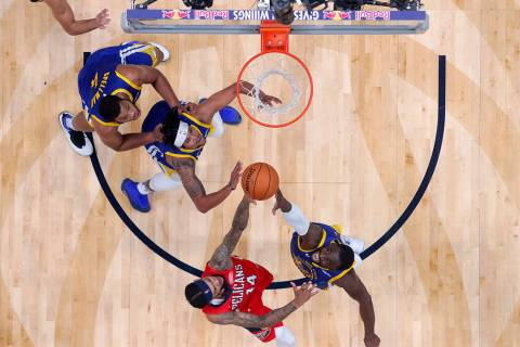 New Orleans Pelicans forward Brandon Ingram (14) and Golden State Warriors forward Draymond Gre ...