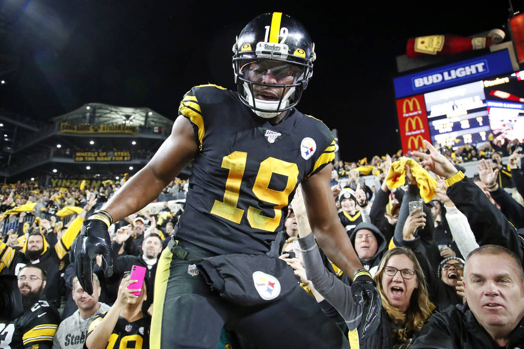 Pittsburgh Steelers wide receiver JuJu Smith-Schuster (19) climbs down from the stands after ce ...