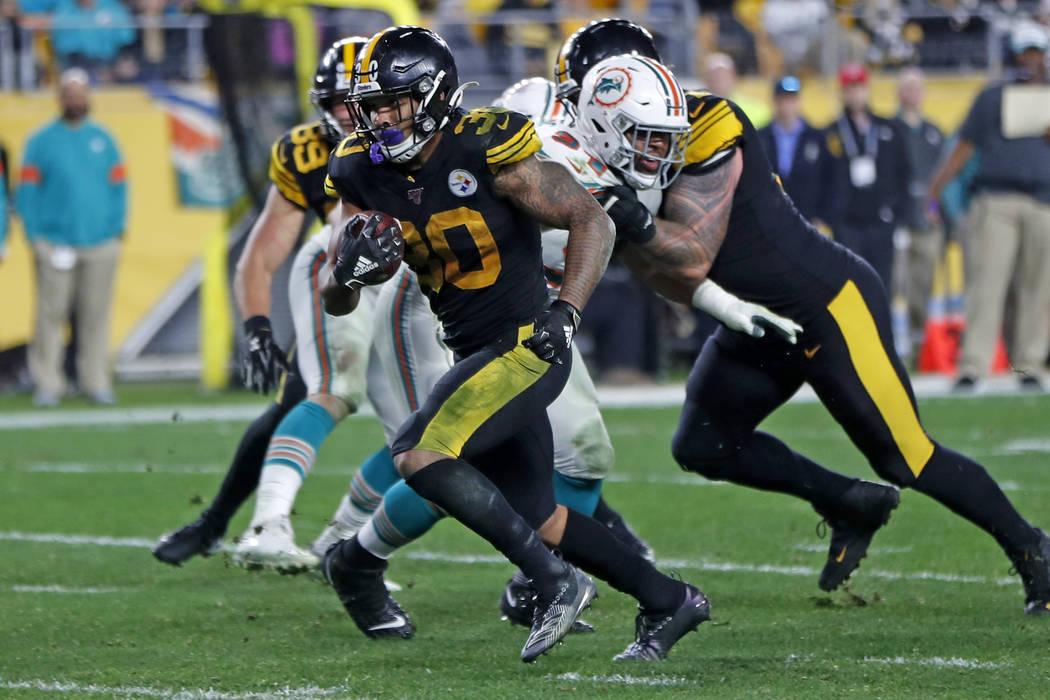 Pittsburgh Steelers running back James Conner (30) rushes for a touchdown during the second hal ...