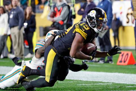 Pittsburgh Steelers wide receiver JuJu Smith-Schuster (19) falls into the end zone for a touchd ...
