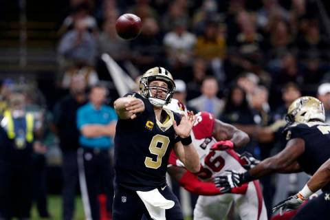 New Orleans Saints quarterback Drew Brees (9) passes in the first half of an NFL football game ...