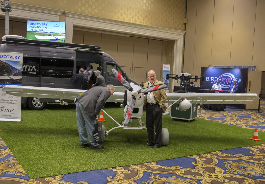 Shannon Marino, bottom/left, and Bobby Dean, with PCRG, take a look at Uavita Systems Sarl's Di ...