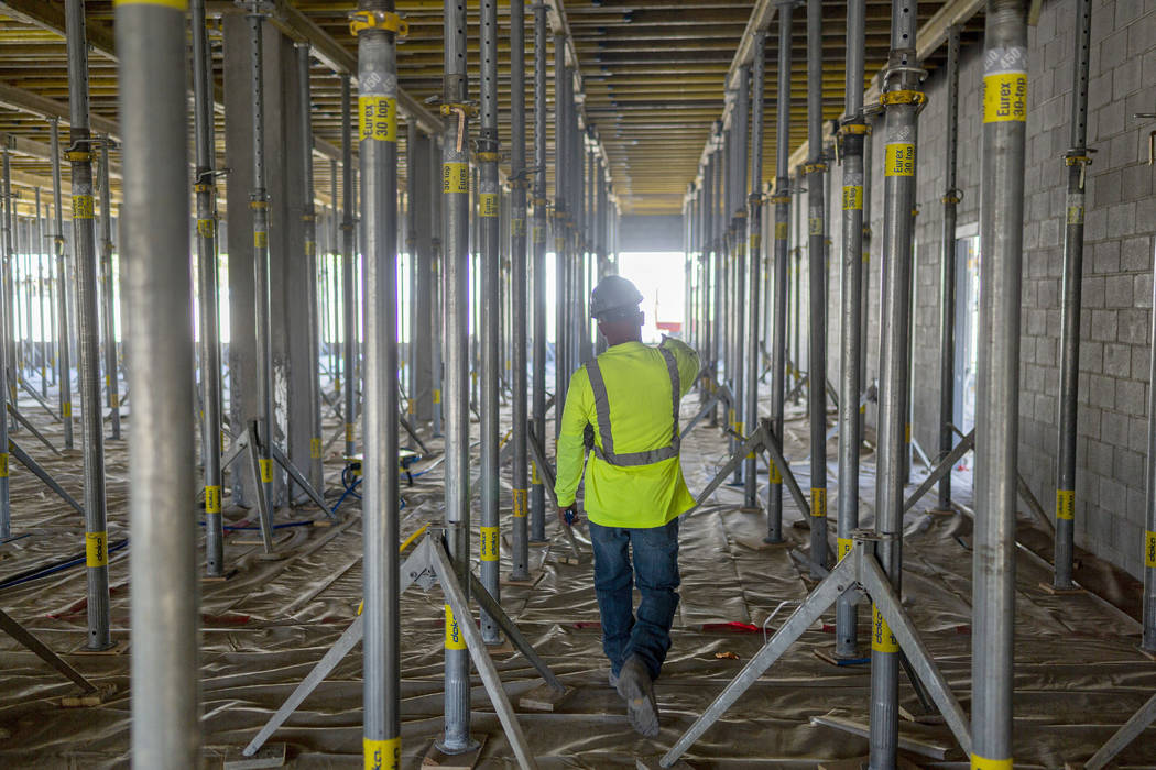 Breslin Builders superintendent Mike Vivier gives a tour of the parking garage construction tha ...