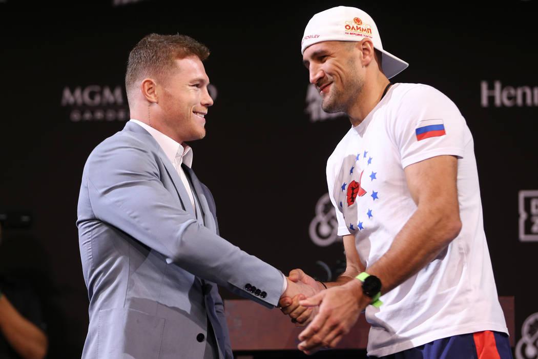 "Saul ""Canelo"" Alvarez, left, and Sergey Kovalev, pose during a press conference for t ..."