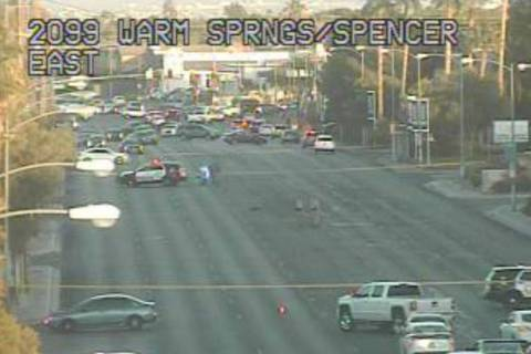Police investigate a crash on the 2100 block of East Warm Springs Road in Las Vegas. (Nevada De ...