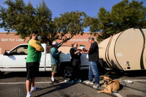 Kincade Fire evacuee Larisa Figueroa gets a gift trailer from Gilbert Lemus while camped in a R ...