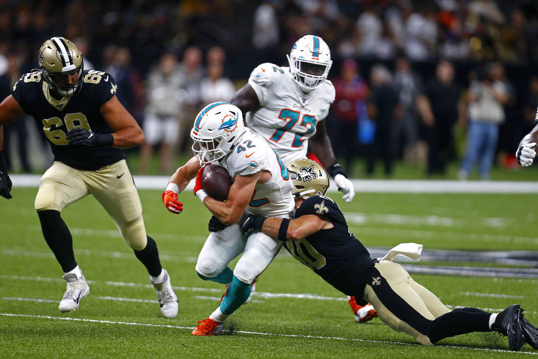 Miami Dolphins running back Patrick Laird (42) carries against New Orleans Saints inside lineba ...