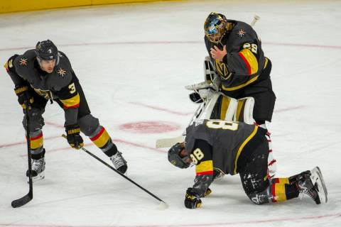Vegas Golden Knights defenseman Nate Schmidt (88) is down injured on the ice versus the San Jos ...