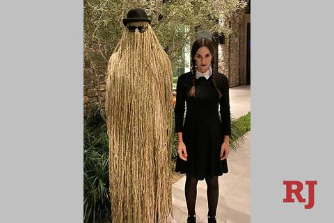 Golden Knights' Marc-Andre Fleury and his wife, Veronique Larosee Fleury, dressed as Cousin Itt ...