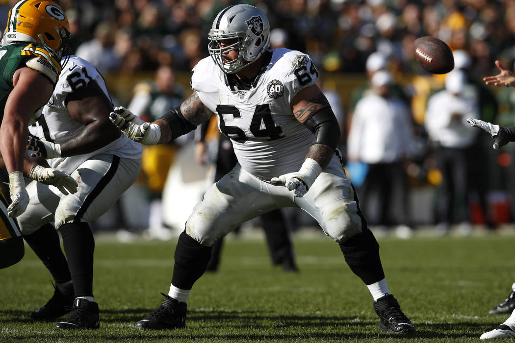 Oakland Raiders center Richie Incognito (64) sets to block against the Green Bay Packers during ...
