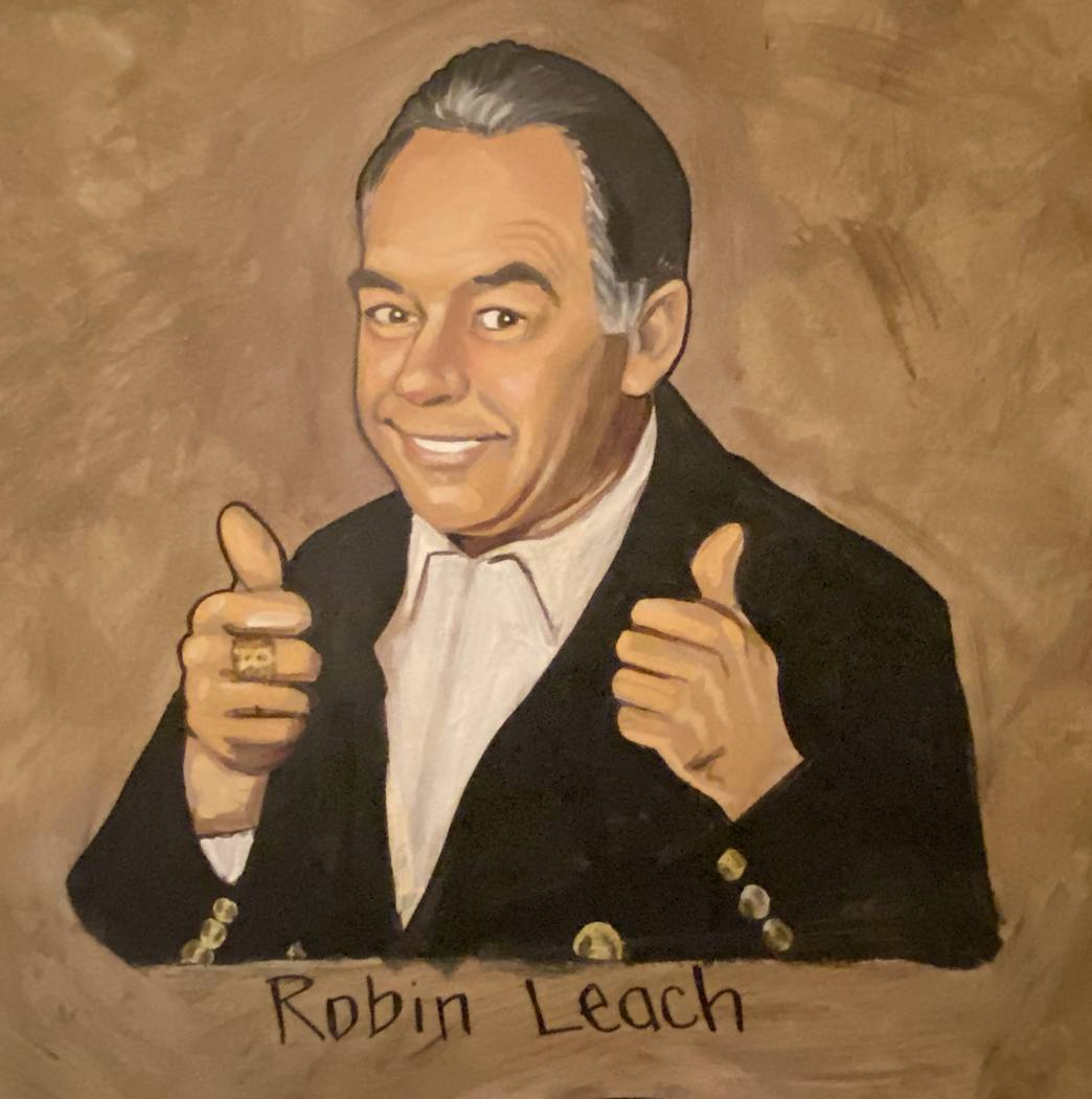 Robin Leach's image is shown on the wall of Palm Restaurant at the Forum Shops at Caesars. (Joh ...