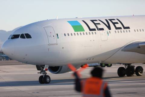Level's first non-stop transatlantic flight between Paris and Las Vegas taxis to its gate at Mc ...