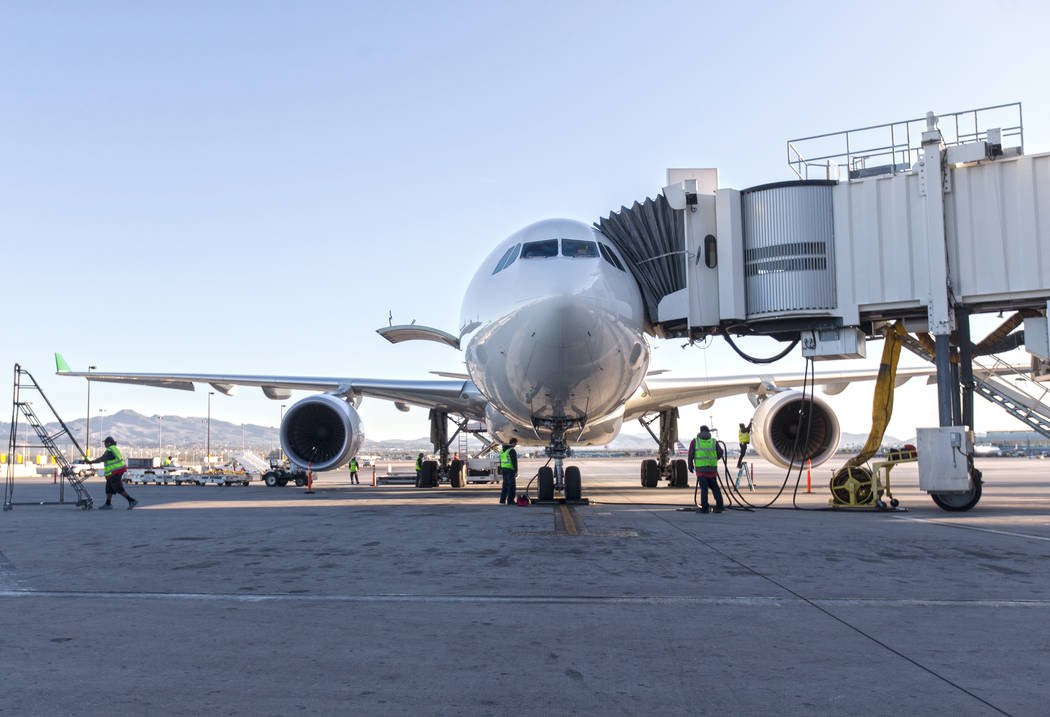 Airline workers inspect Level's first non-stop transatlantic service between Paris and Las Vega ...