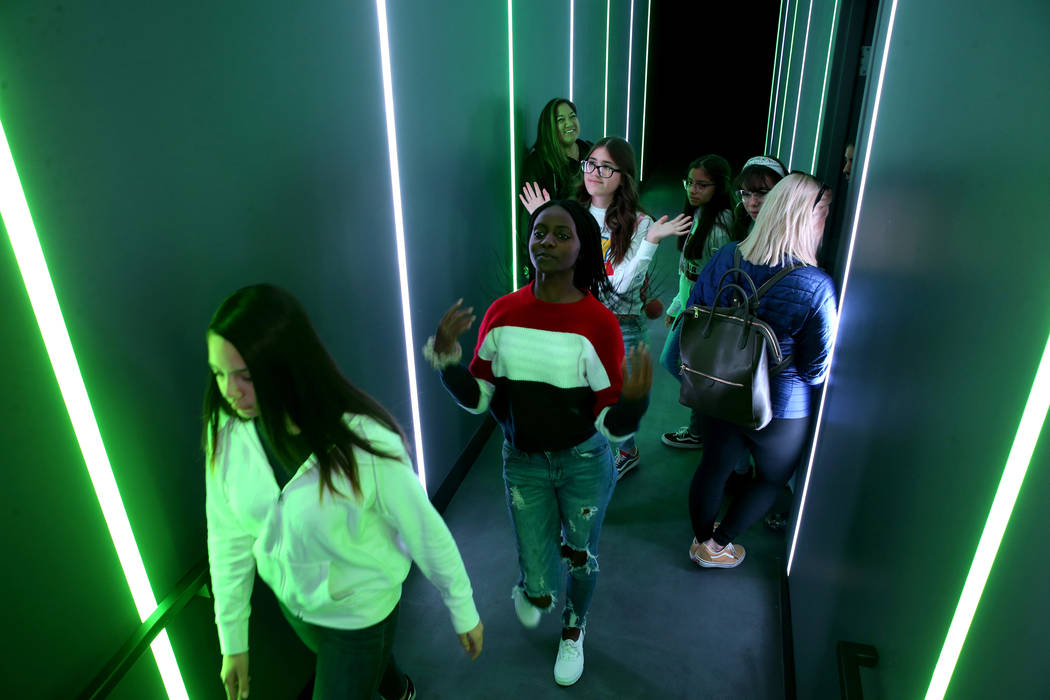 Eighth graders, including from left, Morgan Miller, Natalia Muriithi and Valeria Falcon, all 13 ...