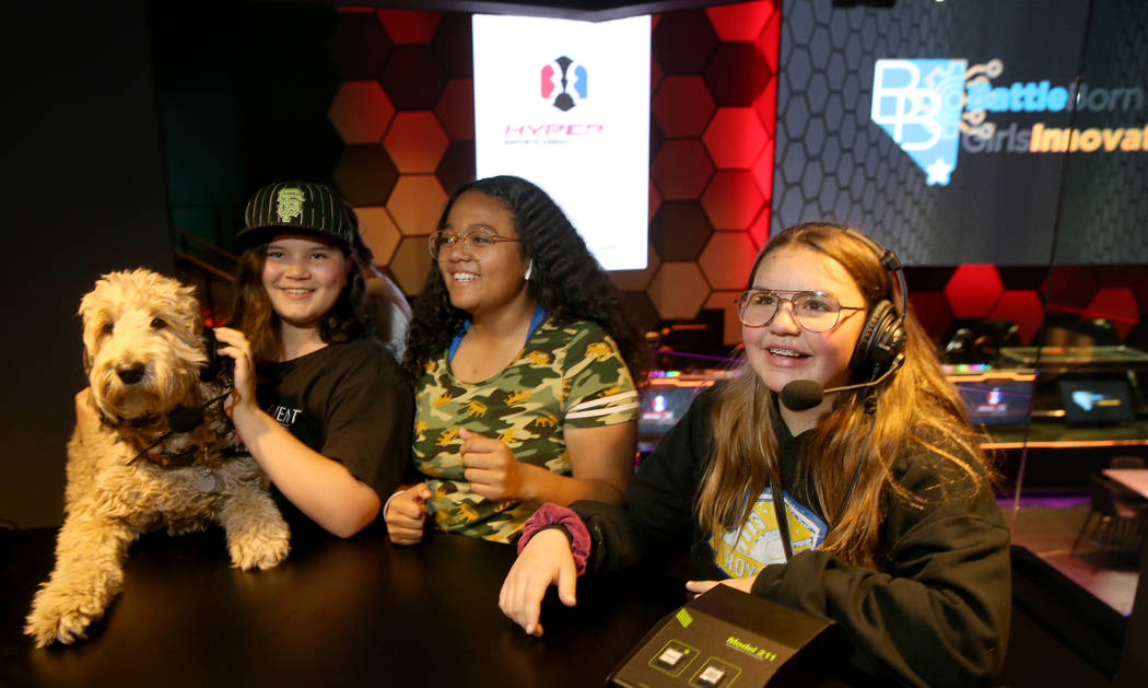 Eighth graders, from left, Sydney Ferguson, with her dog Fluffy, Jaelina Richardson and Rebeka ...