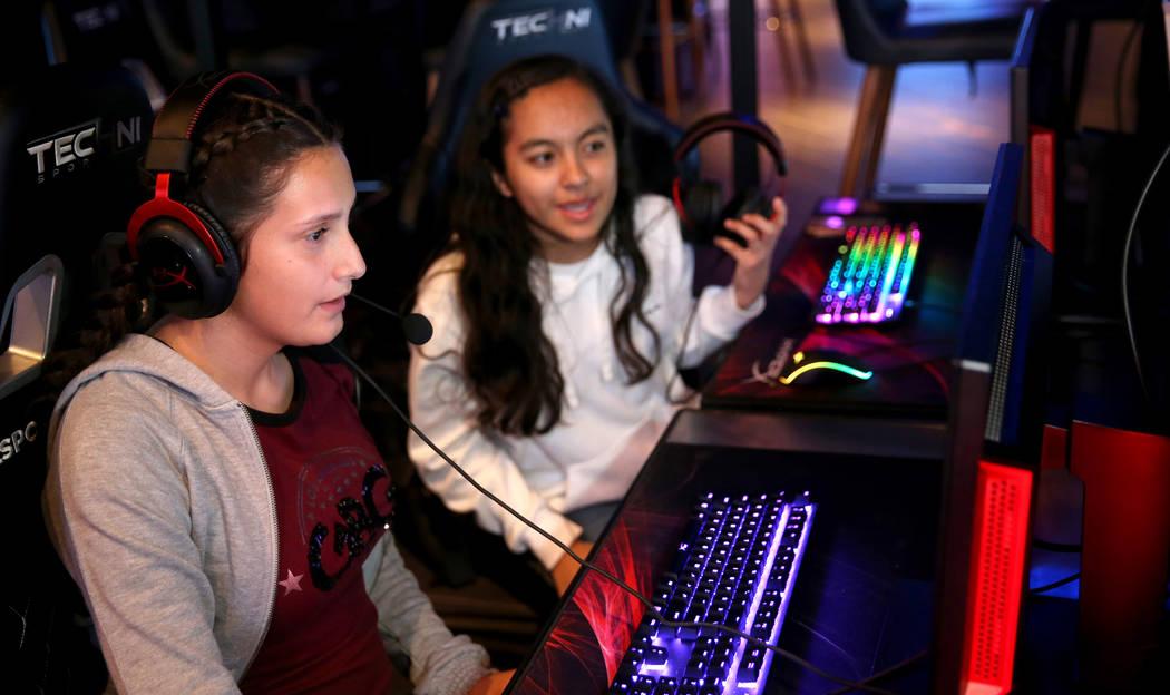 Eighth graders Sarahie Quinonez, left, and Alexa Martinez, both 13, play esports during Battle ...