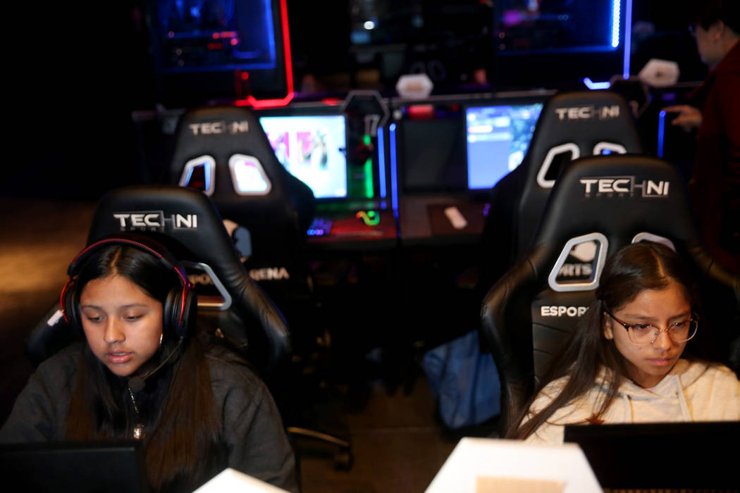Eighth graders Yareli Martinez, 14, and Jimena Orozco, 13, play esports during Battle Born Girl ...