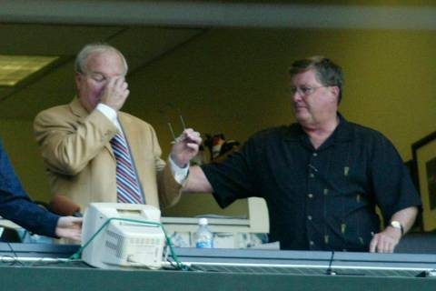 Seattle Mariners' radio announcer Dave Neihaus, left, wipes his eyes as Ron Fairly, right, reac ...