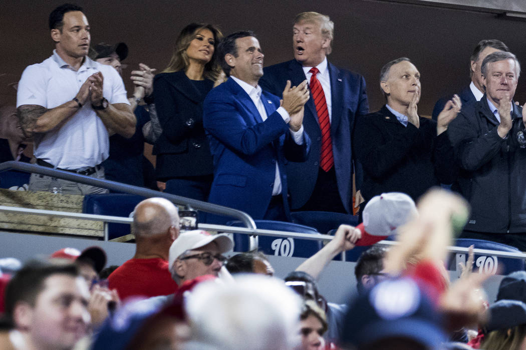 President Donald Trump, third from right, accompanied by first lady Melania Trump, second from ...