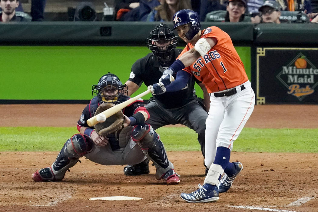 Houston Astros' Carlos Correa hits a RBI-single against the Washington Nationals during the fif ...