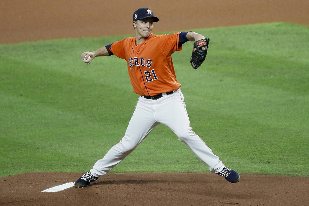 Houston Astros starting pitcher Zack Greinke throws against the Washington Nationals during the ...