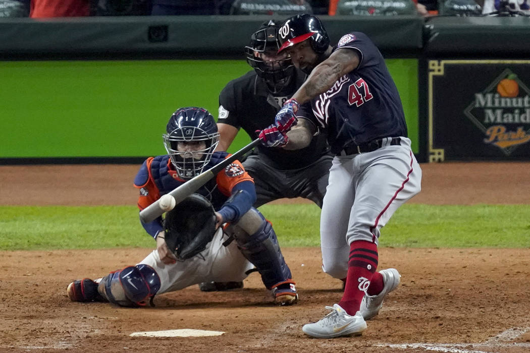 Washington Nationals' Howie Kendrick hits a two-run home run against the Houston Astros during ...