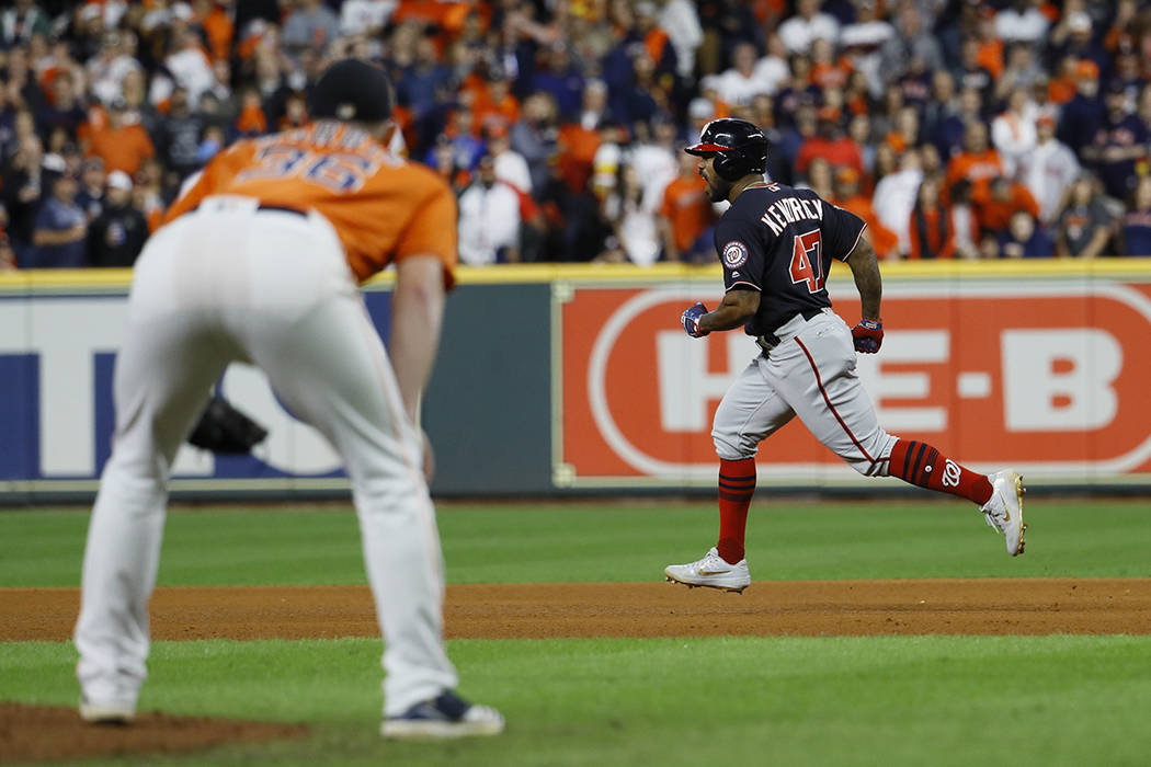 Houston Astros relief pitcher Will Harris watch as Washington Nationals' Howie Kendrick reacts ...