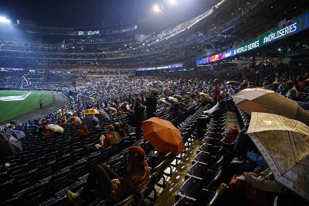 Washington Nationals fans watch television coverage of Game 7 of the baseball World Series in t ...