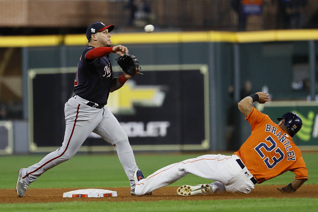 Houston Astros' Michael Brantley is out as Washington Nationals' Asdrubal Cabrera tries to doub ...