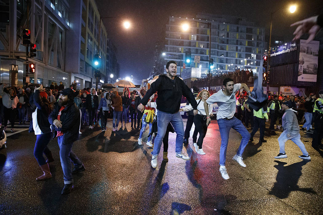 Washington Nationals fans celebrate early Thursday, Oct. 31, 2019, in Washington after the Wash ...