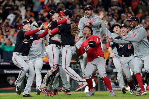 Washington Nationals' Yan Gomes and Daniel Hudson celebrate after Game 7 of the baseball World ...