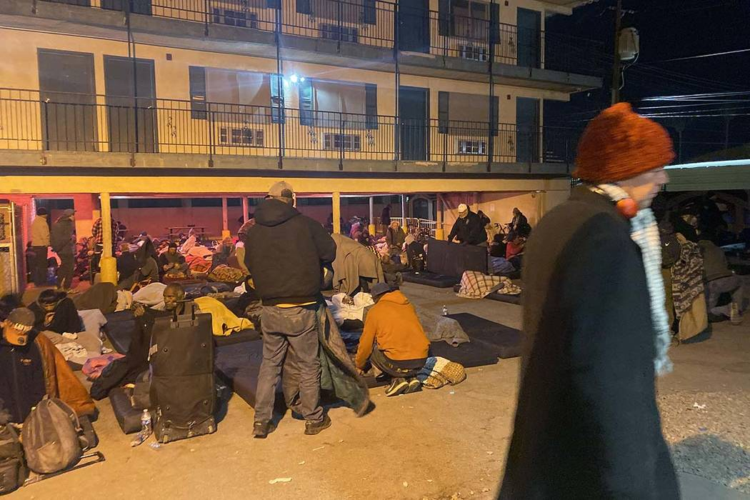 Homeless people rise early Thursday, Oct. 31, 2019, after spending the night at the city of Las ...