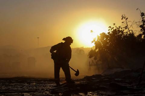 A firefighter puts out hotspots in Simi Valley, Calif., Wednesday, Oct. 30, 2019. (AP Photo/Rin ...