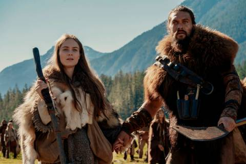 This image released by Apple TV Plus shows Jason Momoa, right, and Hera Hilmar in a scene from ...