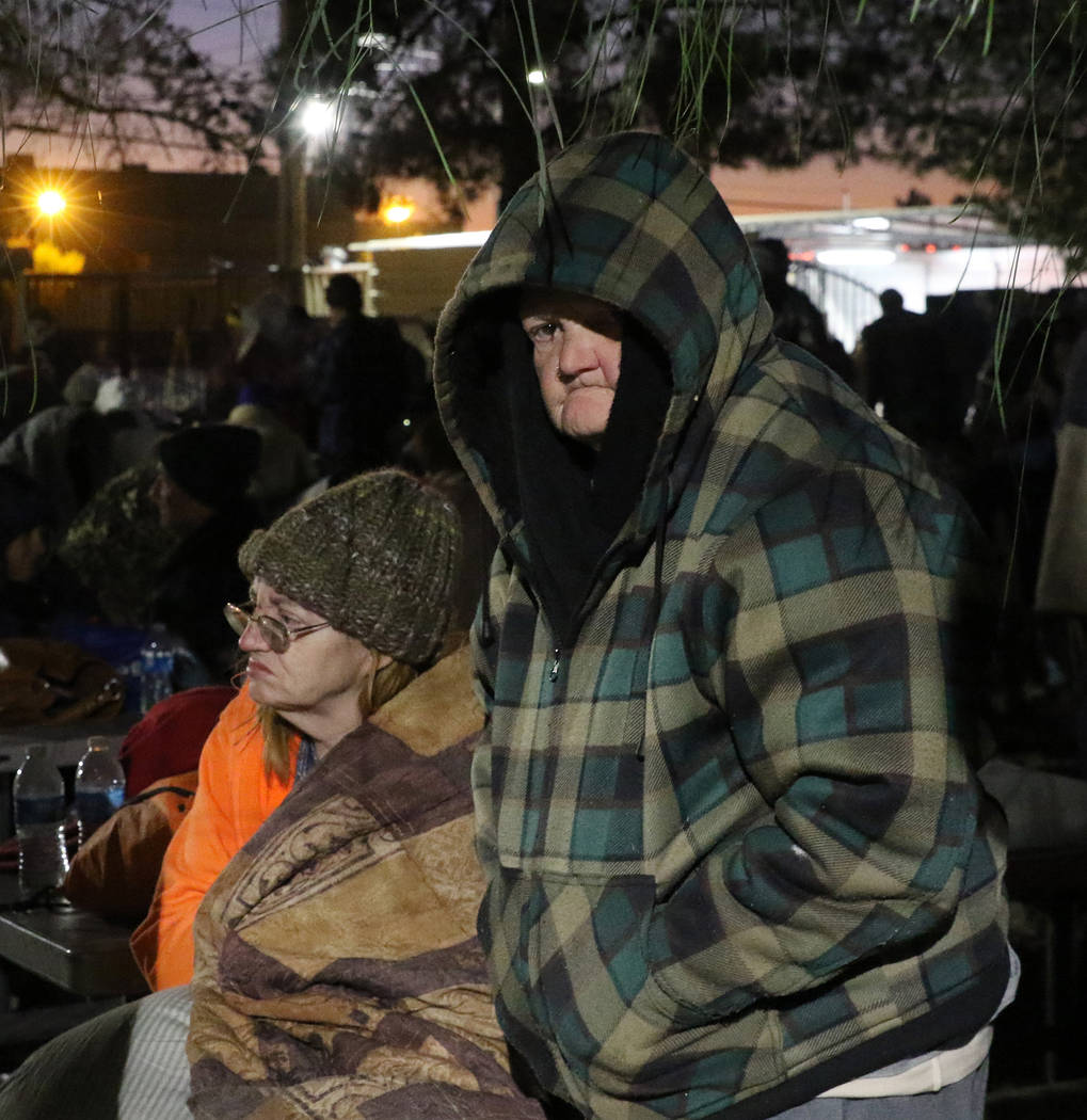 Clients, including Wanda Bradford, 77, try to keep warm at Courtyard Homeless Resource Center o ...