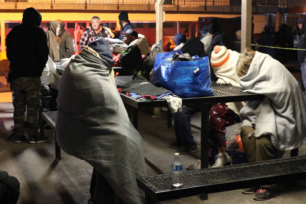 Clients try to keep warm at Courtyard Homeless Resource Center on Thursday, Oct. 31, 2019, in L ...
