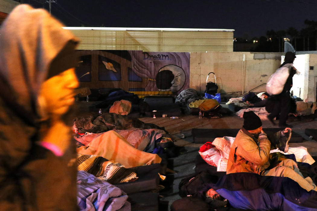 Clients sleep at Courtyard Homeless Resource Center on Thursday, Oct. 31, 2019, in Las Vegas. ( ...